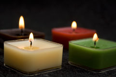 Candles. Four candles on dark background Royalty Free Stock Photography