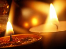 Candles. Warm Candle's Light and Glass Ball in background Royalty Free Stock Photos