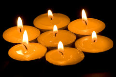 Candles. Isolated on black background Stock Photo
