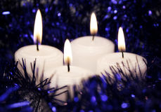 Candles. Four white candles in soft focus Royalty Free Stock Images