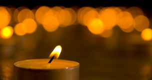 Candles. Close up view of the candles in the darkness royalty free stock photo