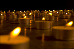 Candles. Close up view of the candles in the darkness royalty free stock photography
