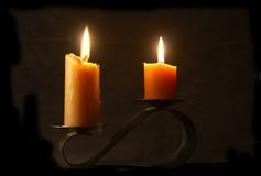 Candles. Two burning candles on black sconce at the darkness Stock Photography