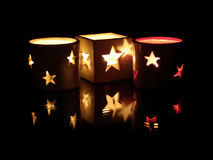 Candles. Three decorative candles with reflection, on a black background Royalty Free Stock Image