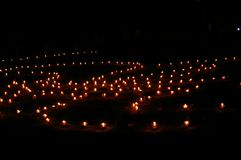 Candles. Many lightened candles are standing on the ground at night Royalty Free Stock Photos