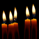 Candles. Five Candles isolated against a dark background Stock Photo