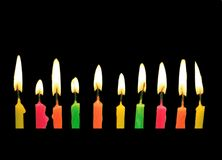 Candles. Candels with burning flame isolated from a birthday party Royalty Free Stock Photography