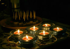 Candles. Six candles and snacks in the background. Evening mood Royalty Free Stock Images