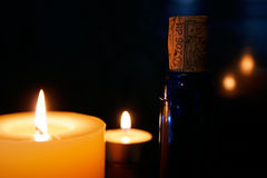 Candles. And bottle Royalty Free Stock Image