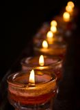 Candles. Row of candles in a dark background Stock Photography