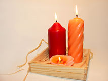 Candles. Three warm candles Royalty Free Stock Photography