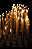 Candles. Rows of candles at the church altar (religion theme stock photo