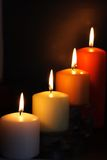 Candles. Four candles on black background Stock Photos