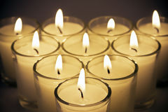 Candles. Horizontal of burning candles in clear glass holders royalty free stock image