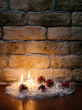 Candles against a wall. Candles against a brick wall Royalty Free Stock Images