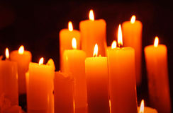 Candles, alight candle on black background. Alight candles on black background Royalty Free Stock Image