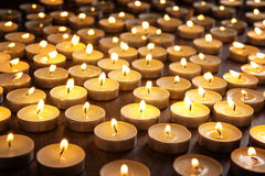 Candles alight on table Stock Image