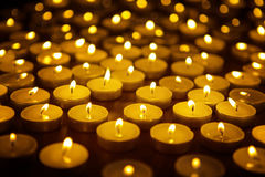 Candles alight on table Royalty Free Stock Image