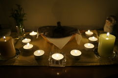 Candles on altar. Nice and cosy candlelight and small altar Stock Photography