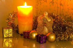 Candles and Angel. Burning candles and Christmas Angel Royalty Free Stock Images