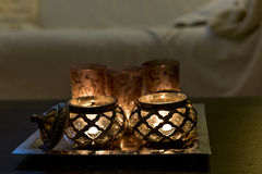Candles arabic on coffee table. Candles arabic on table in home evening dark Royalty Free Stock Image