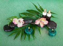 Candles, aroma oil, stones and flowers Stock Photo