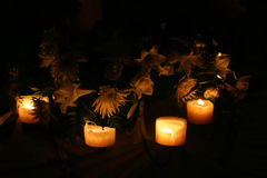 Candles arround flowers. Candles arround a flower setting at a wedding royalty free stock image