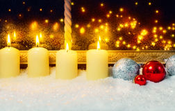 Candles and balls at the window Royalty Free Stock Image