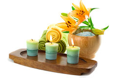 Candles and bath accessories. Spa towels with candles isolated on white Royalty Free Stock Photos