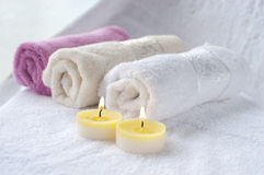 Candles and bath towels Royalty Free Stock Images