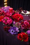 Candles and beautiful flowers on the wedding table.  Stock Photo