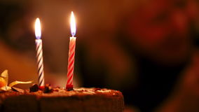 Candles on birthday cake. Two candles on birthay cake burning in the darkness stock video footage