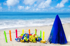 Candles with Birthday decorations on the beach Stock Photos