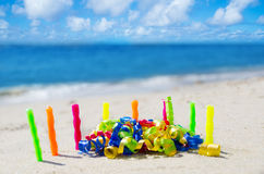 Candles with Birthday decorations on the beach Royalty Free Stock Photography