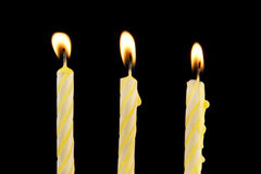 Candles on black background Stock Photos
