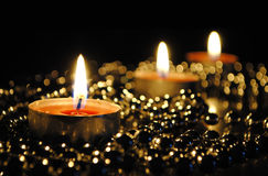 Candles on a black background Stock Images