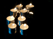 Candles on a black background Stock Photography