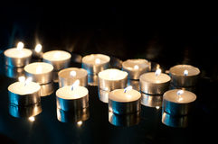 Candles on black Royalty Free Stock Photography