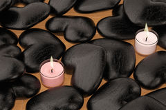 Candles and black stone heart. 3D illustration. Stock Images