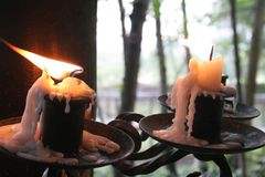 Candles blowing in the wind royalty free stock photography