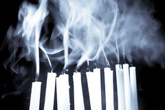 Candles blown out showing rising smoke Stock Image