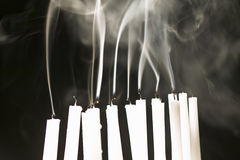Candles blown out showing rising smoke Royalty Free Stock Photography