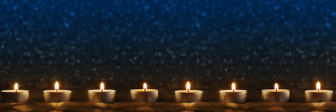 Candles on blue background Royalty Free Stock Photography