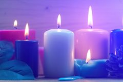 Candles on a blue background. Interiors. The concept of romance Stock Images