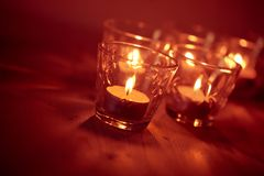 Candles on a blurred background Stock Photo
