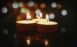 Candles. With bokeh background creating cozy atmosphere royalty free stock photography