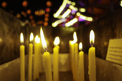 A candles with bokeh. A candles is flaming with the background of bokeh Stock Photo