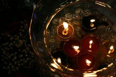 Candles in bowl. Candles with flowers and glass jar Royalty Free Stock Photos