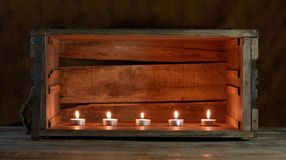 Candles in a box. Five candles in a wooden box royalty free stock photography