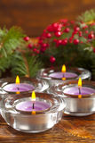 Candles and branch of christmas tree Stock Photography